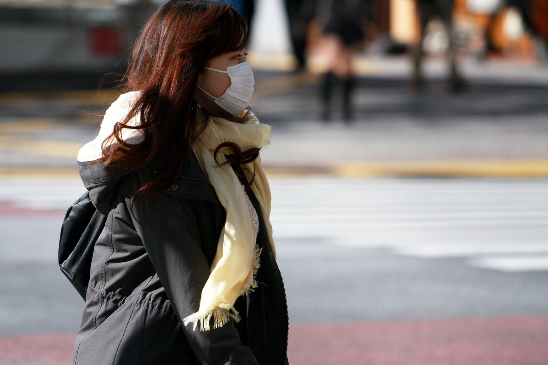 woman walking in shibuya japan