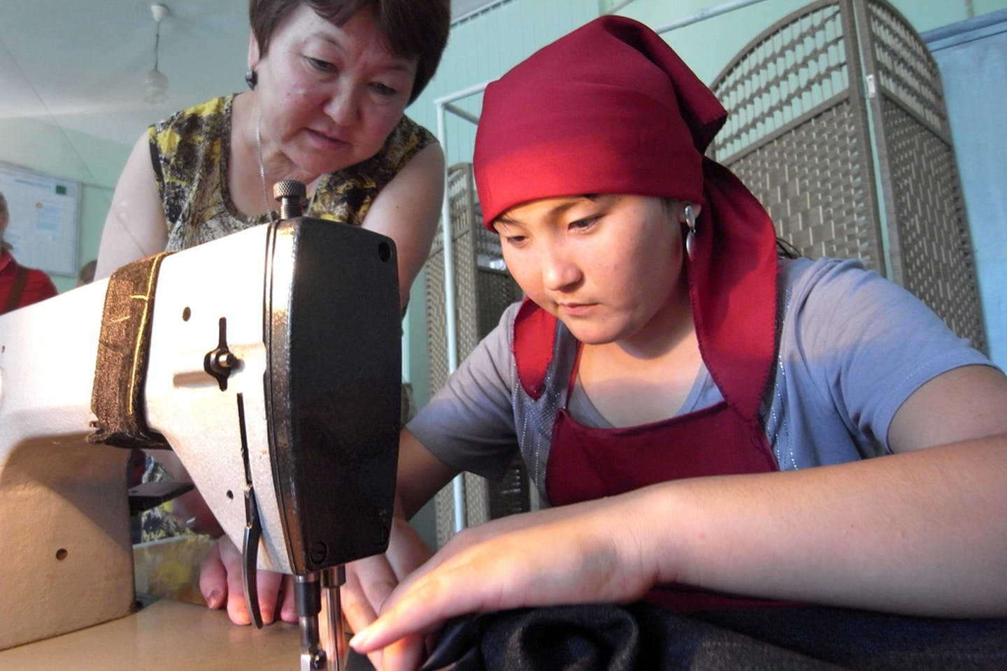 A student at a vocational school in Osh, Kyrgyzstan practices her sewing