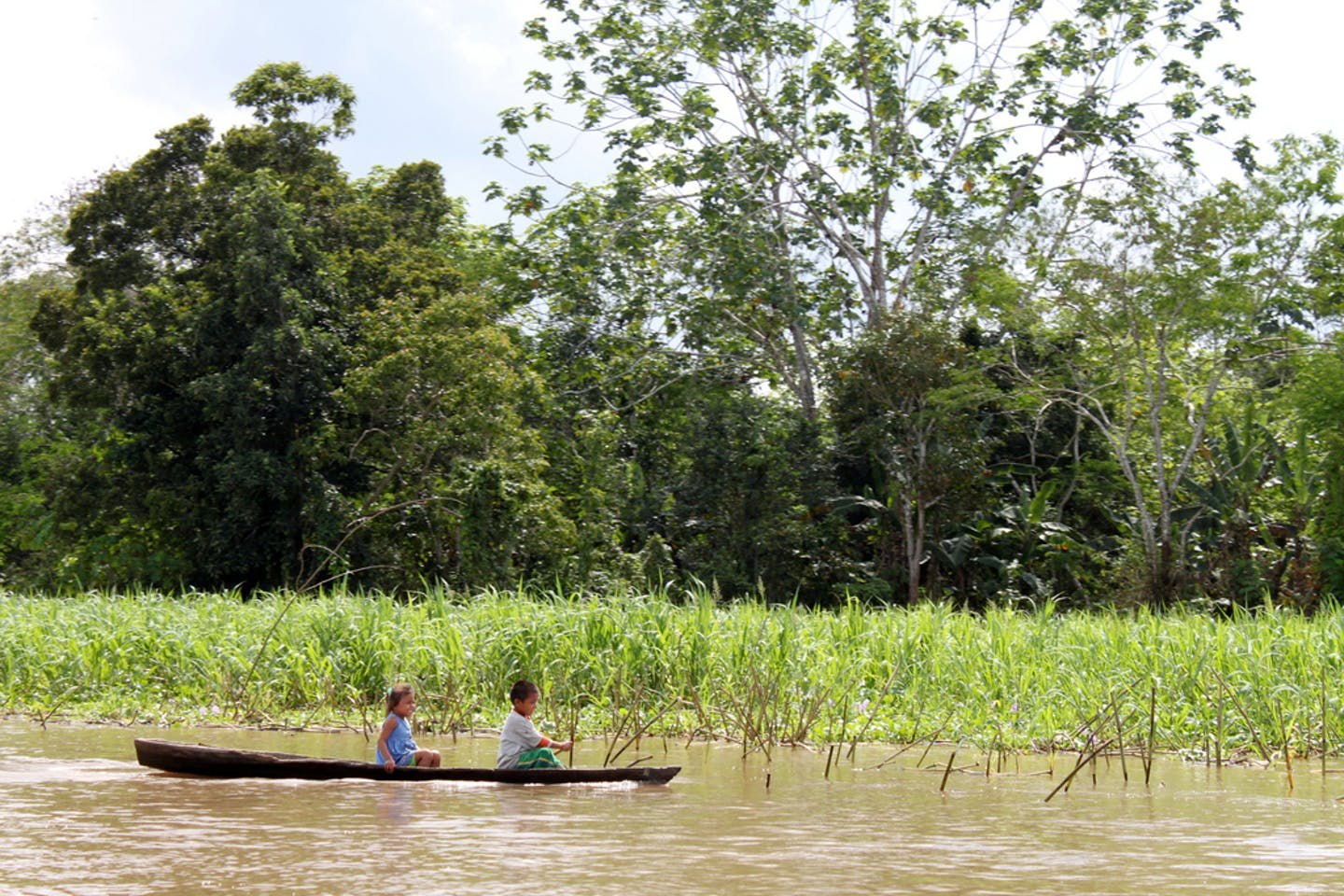 Children in a boat in the Colombian Amazon.