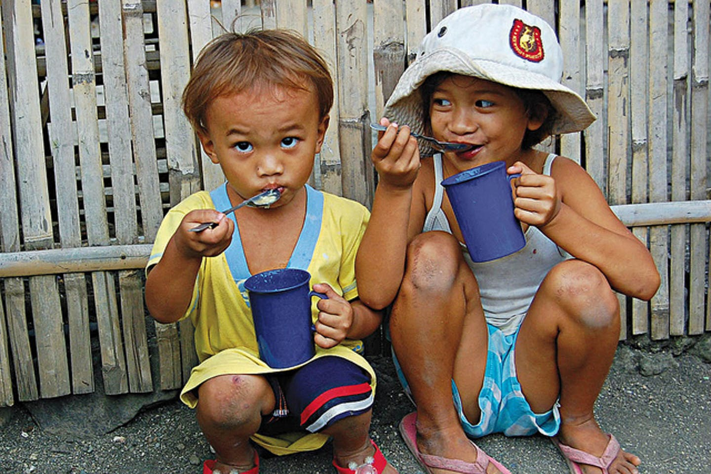 children eat rice and broth