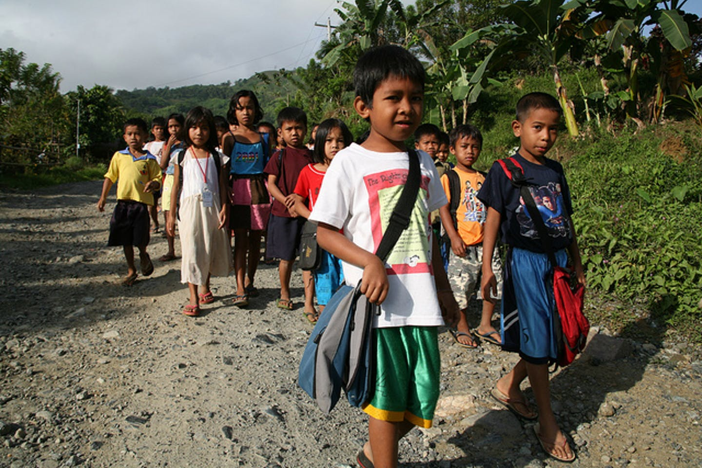 Filipino children walk to school
