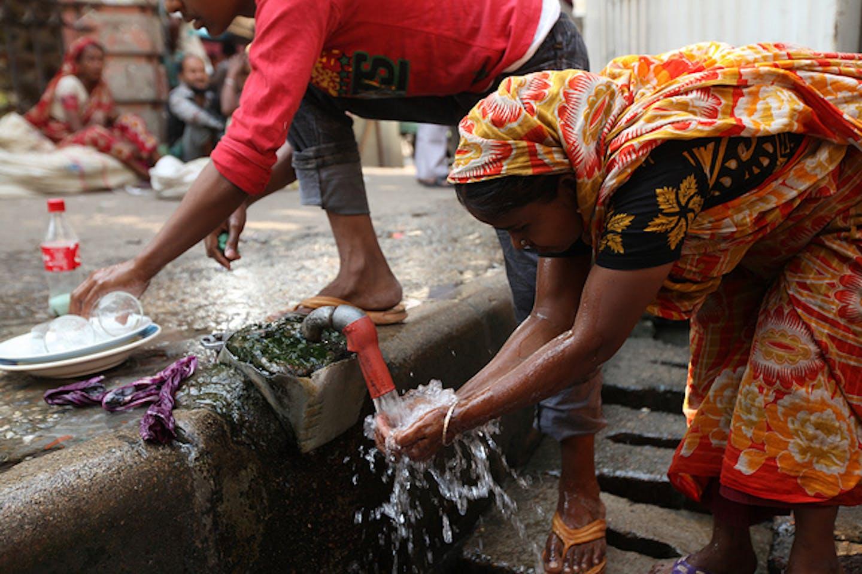 water from roadside tap in Dhaka