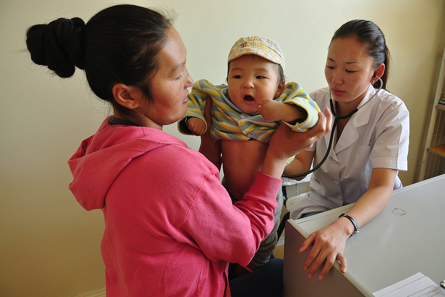 Doctors and other health workers serve a steady stream of patients in a modern clinic in Zuunmod town