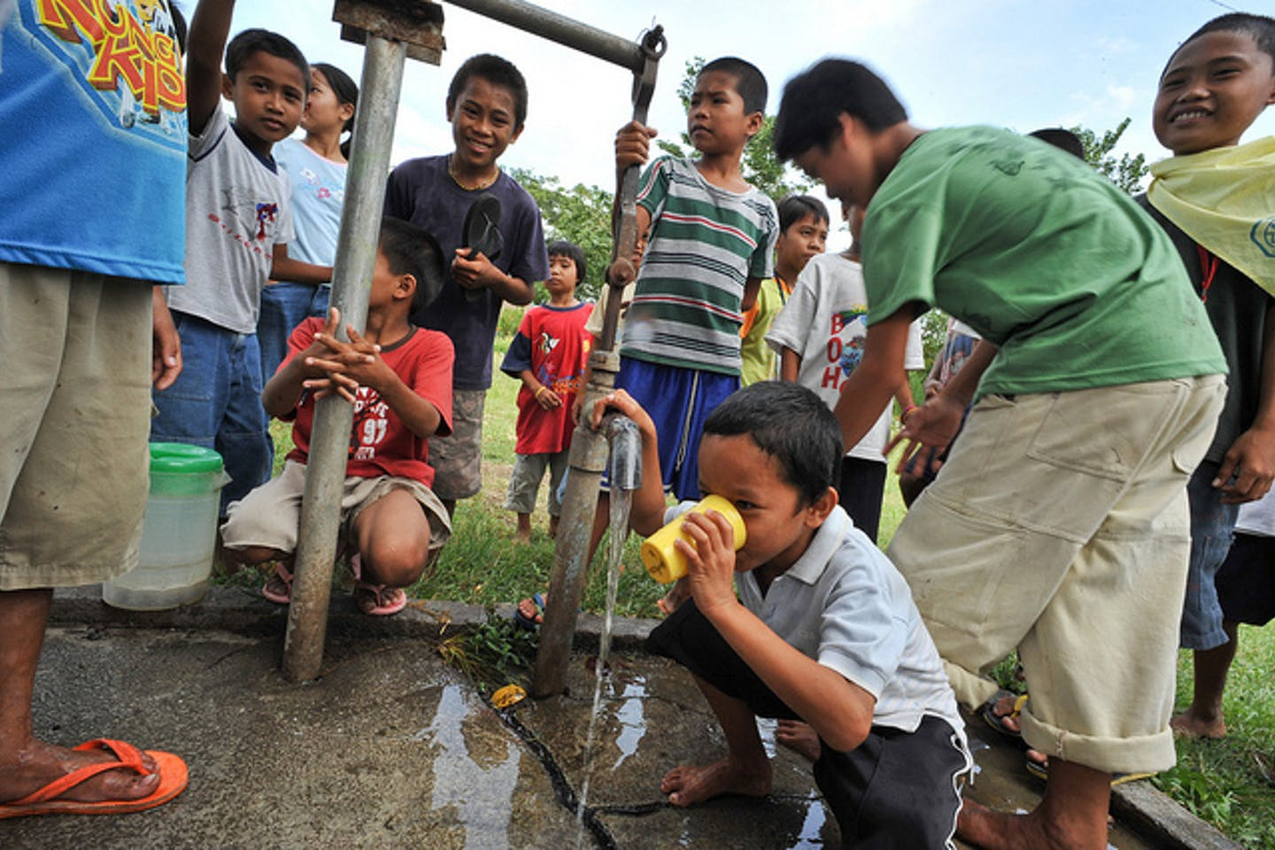 children drink water from tap
