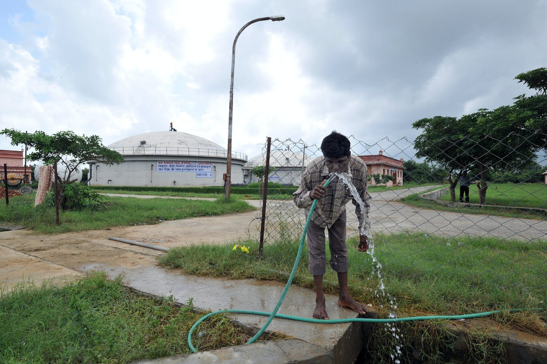 man drinking water pipe