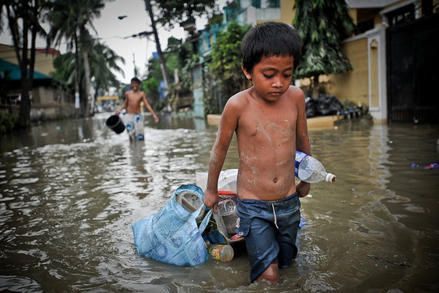boy in flooded streets
