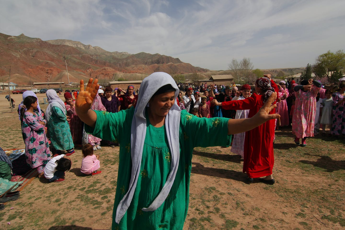 Women dance during the Navruz Holiday in Chanori Suhta Village in Tajikistan