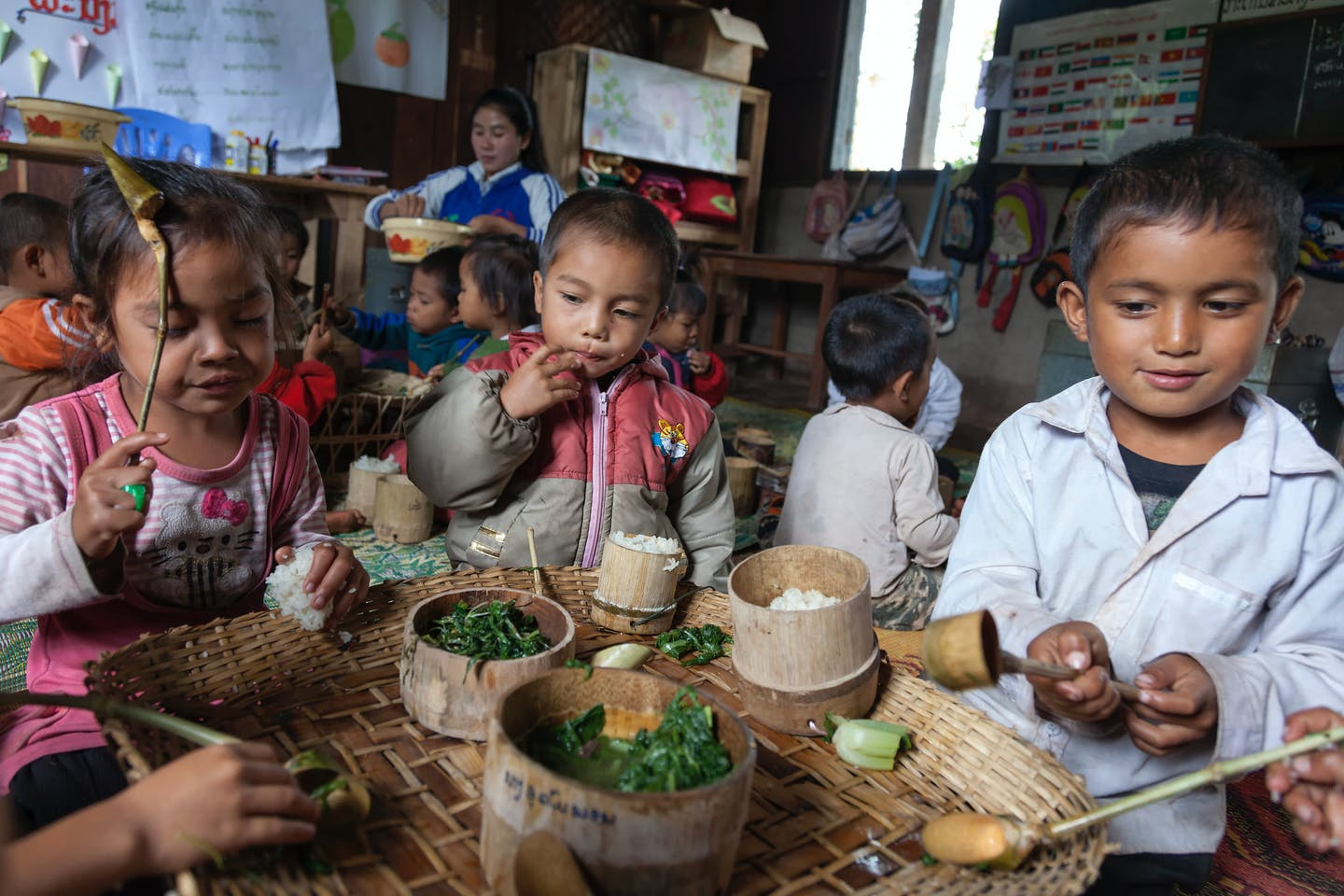 Children in Laos eating traditional foods