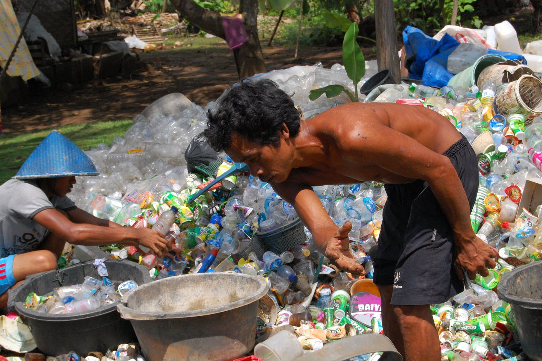 man sorts plastic waste