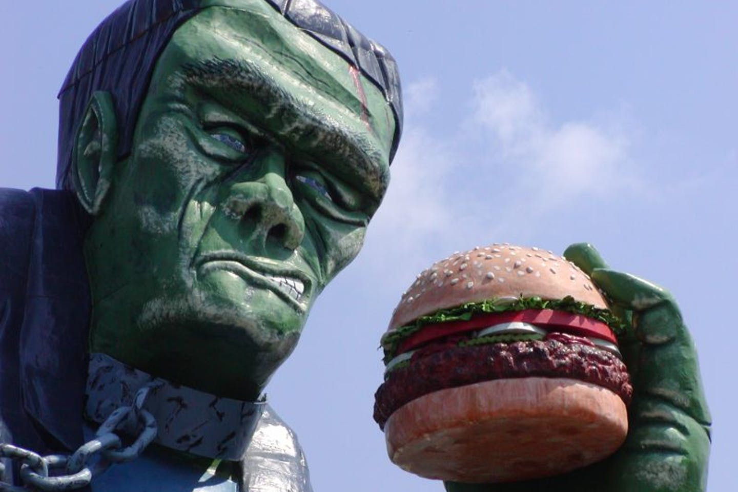 Frankenstein's monster eating a hamburger