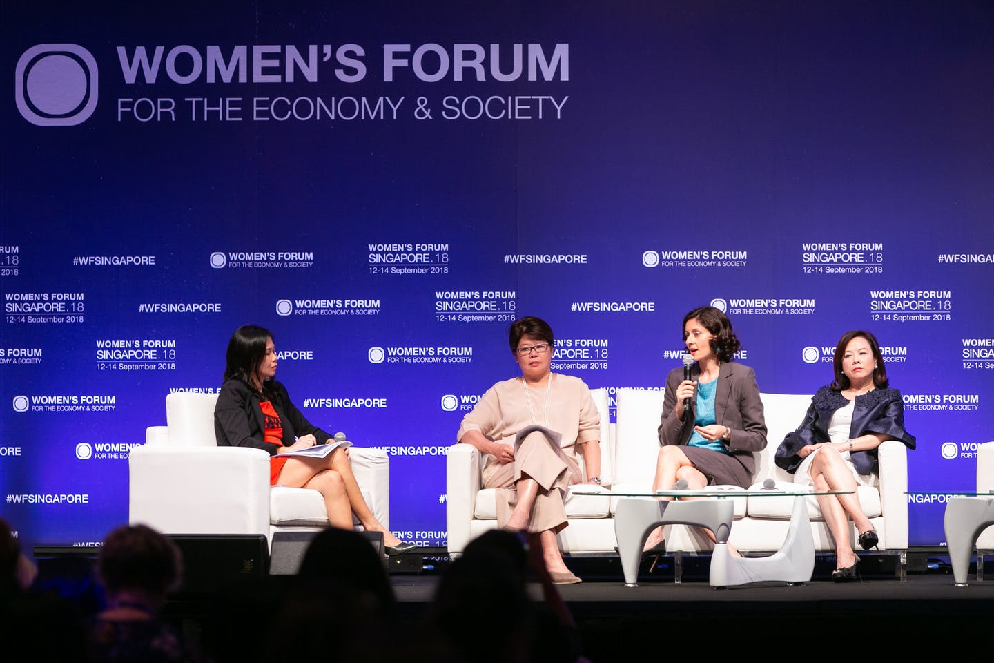 Experts from industry and civil society discuss the role of women in advancing the climate agenda in a panel titled 'Tackling Climate Change: Designing ASEAN's sustainable future.' Image: Women's Forum / Sipa Press