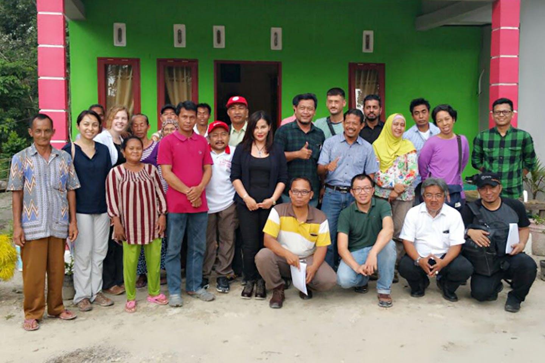 Aida with community members in Riau