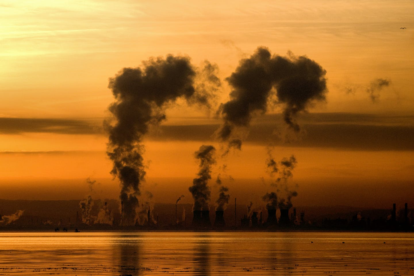 A sunset behind an oil refinery in Scotland