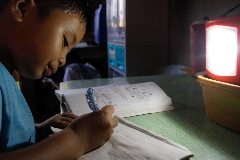 boy studies by the light