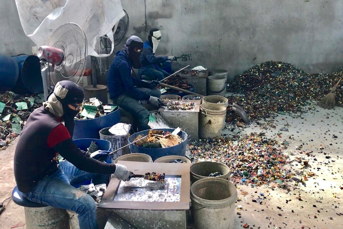 Electronic waste being processed in an informal setting in Thailand. Image: Basel Action Network