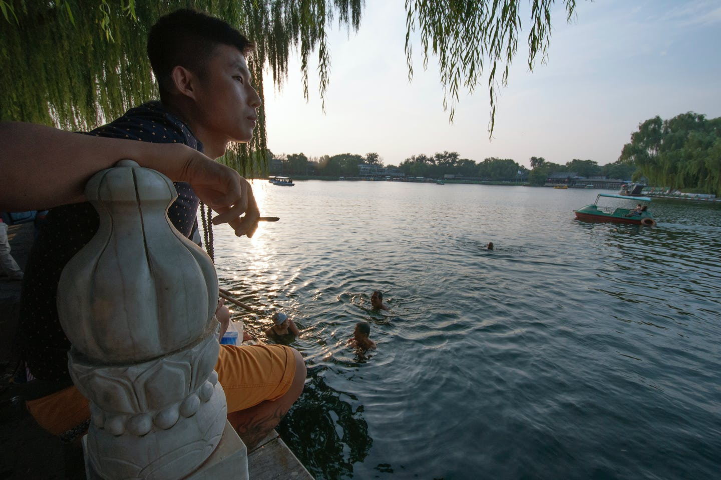cooling off by Qianhai Lake in Beijing's Shichahai
