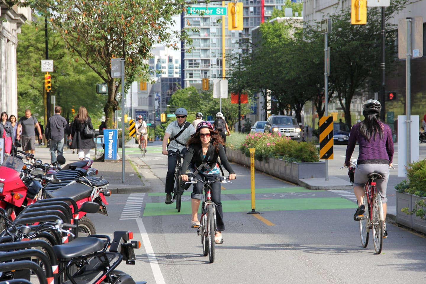 Cyclists on a busy bicycle lane in Vancouver, Canada