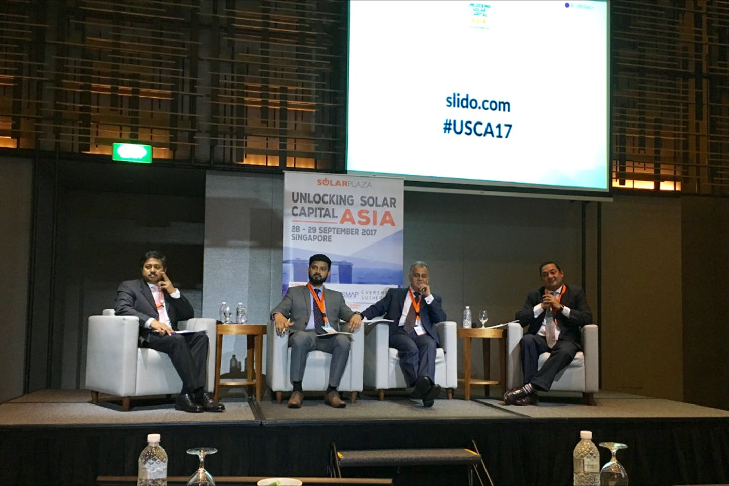 Subrata Barman (far left) of International Finance Corporation fields a heated question from the audience about the criteria for awarding loans at Unlocking Solar Capital Asia. Image: Eco-Business