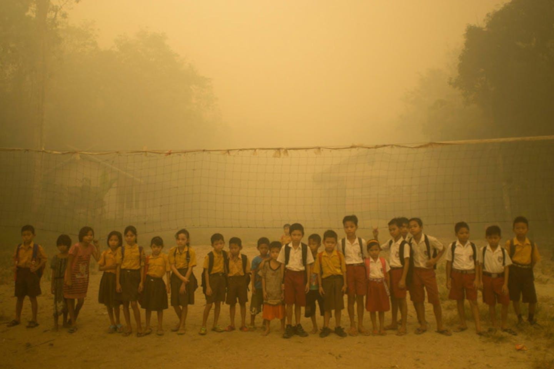 kids enveloped in haze