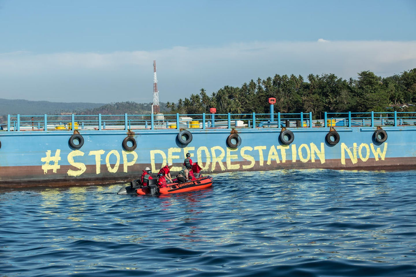 "Greenpeace activists paint ""Stop Deforestation Now"" onto the hull of a palm oil tanker at the Wilmar International refinery in Bitung, North Sulawesi."