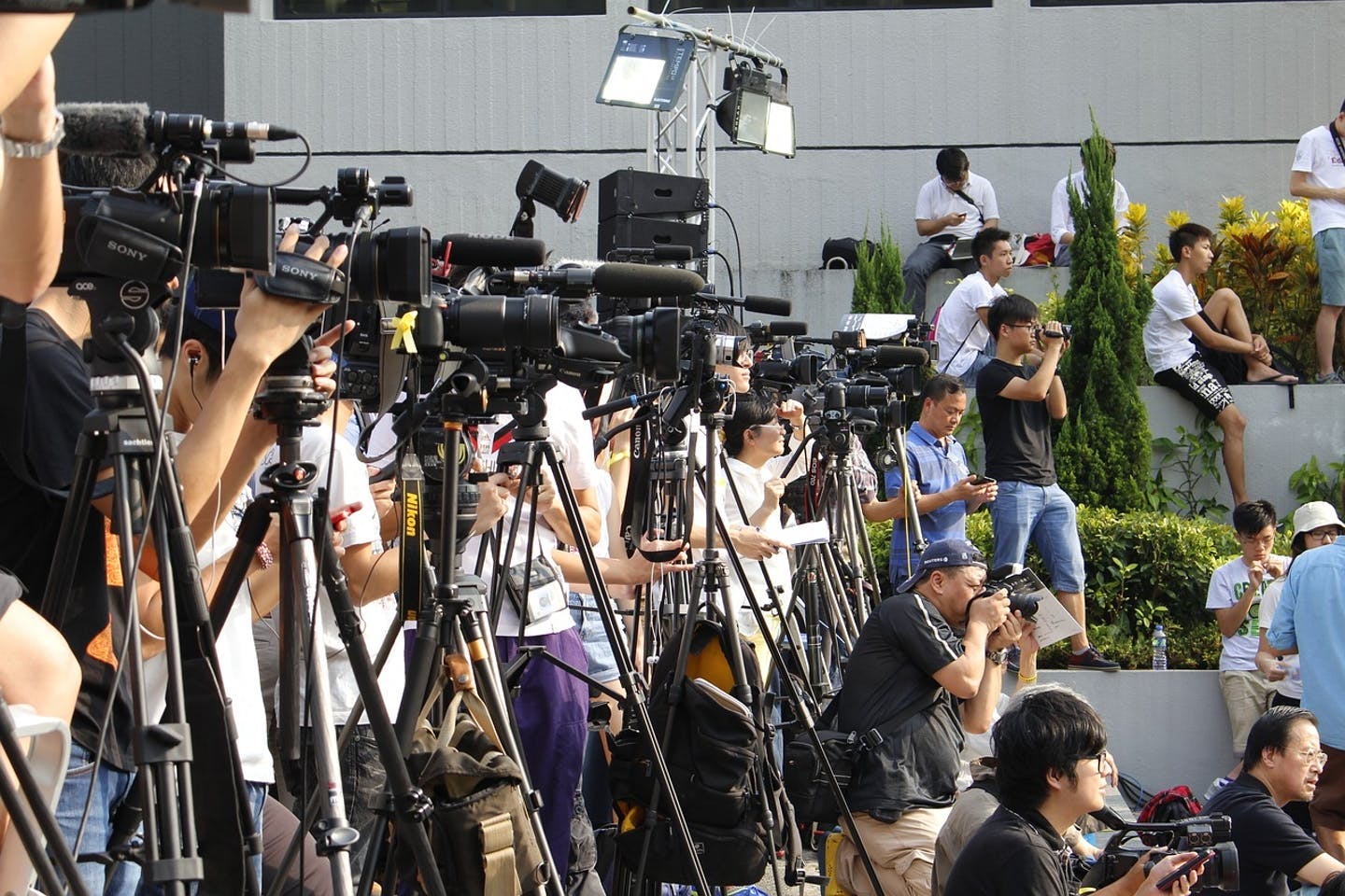 Hong Kong media waiting for a story