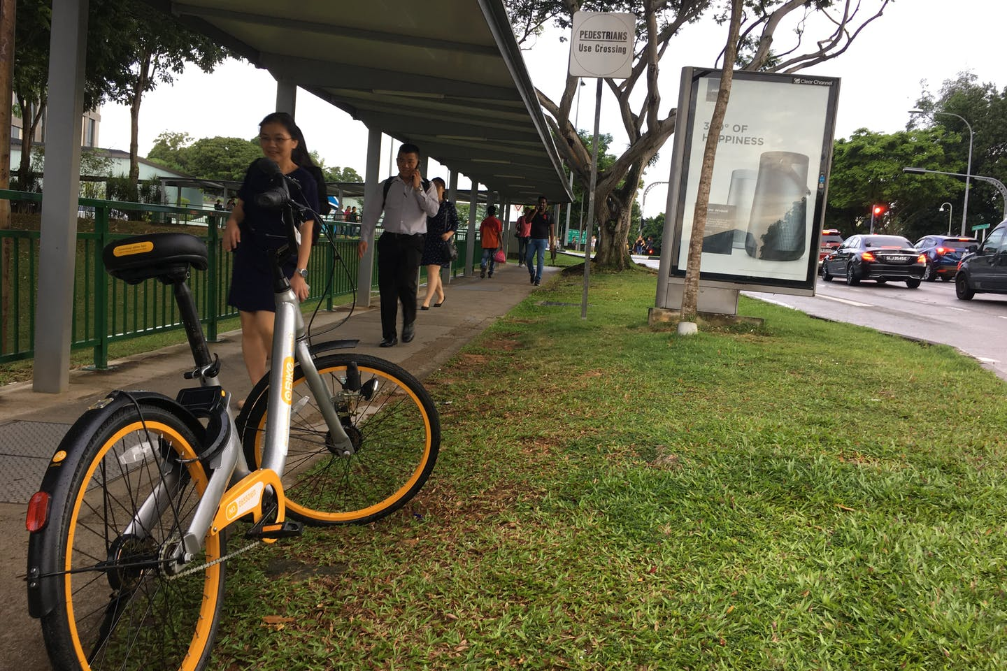 An Obike bicycle is left by a busy walkway near Kent Ridge train station in Singapore. The explosion in use of smart bike-sharing schemes has concerned Singapore's tidiness-conscious government. Image: Eco-Business