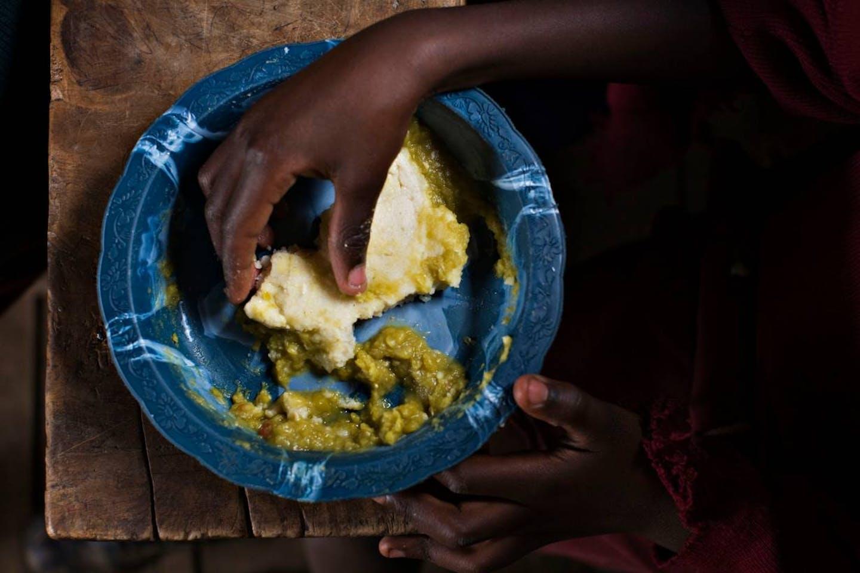 Kibera boy eating food