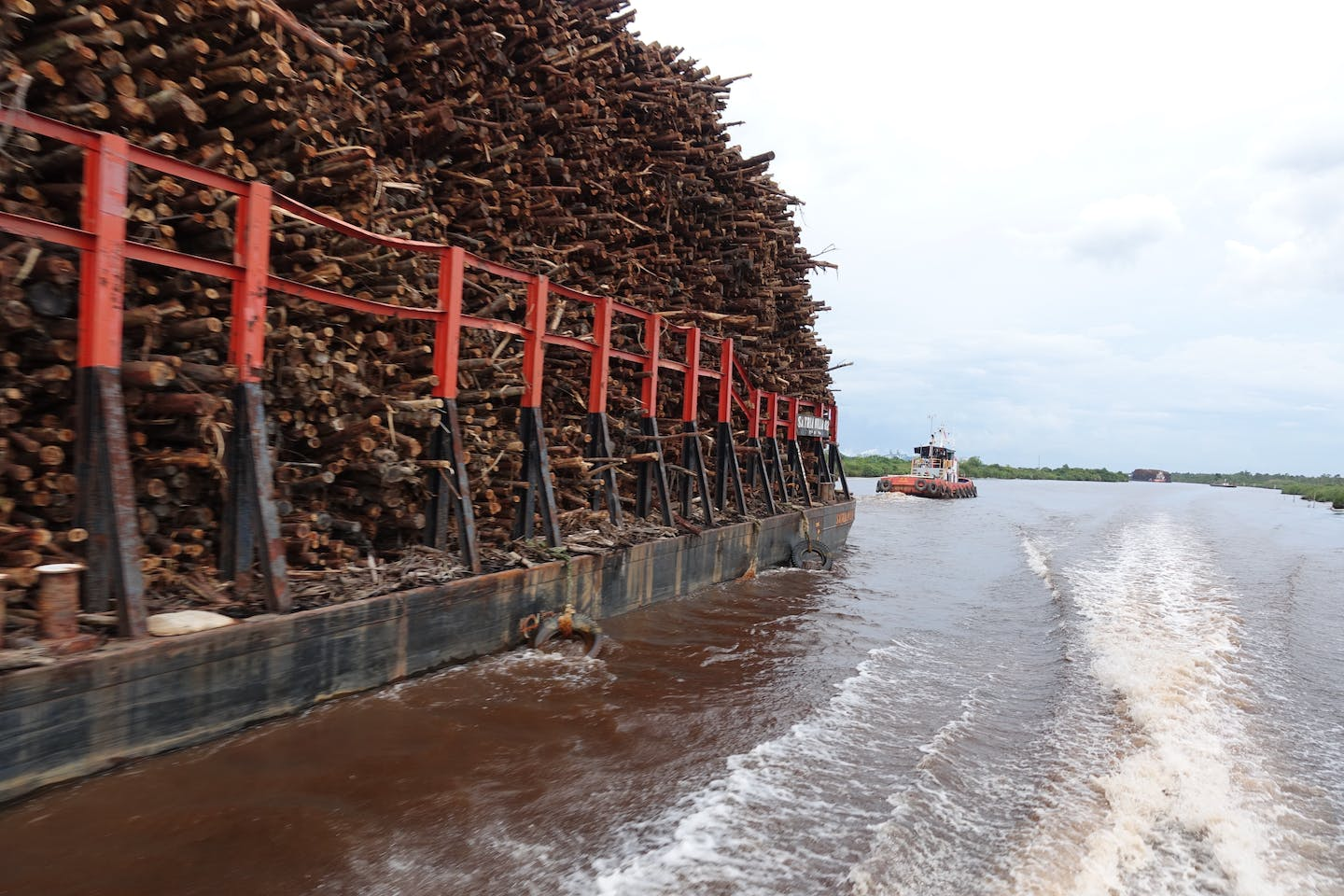 Log barge on Musi River, OKI mill. Image: Eco-Business