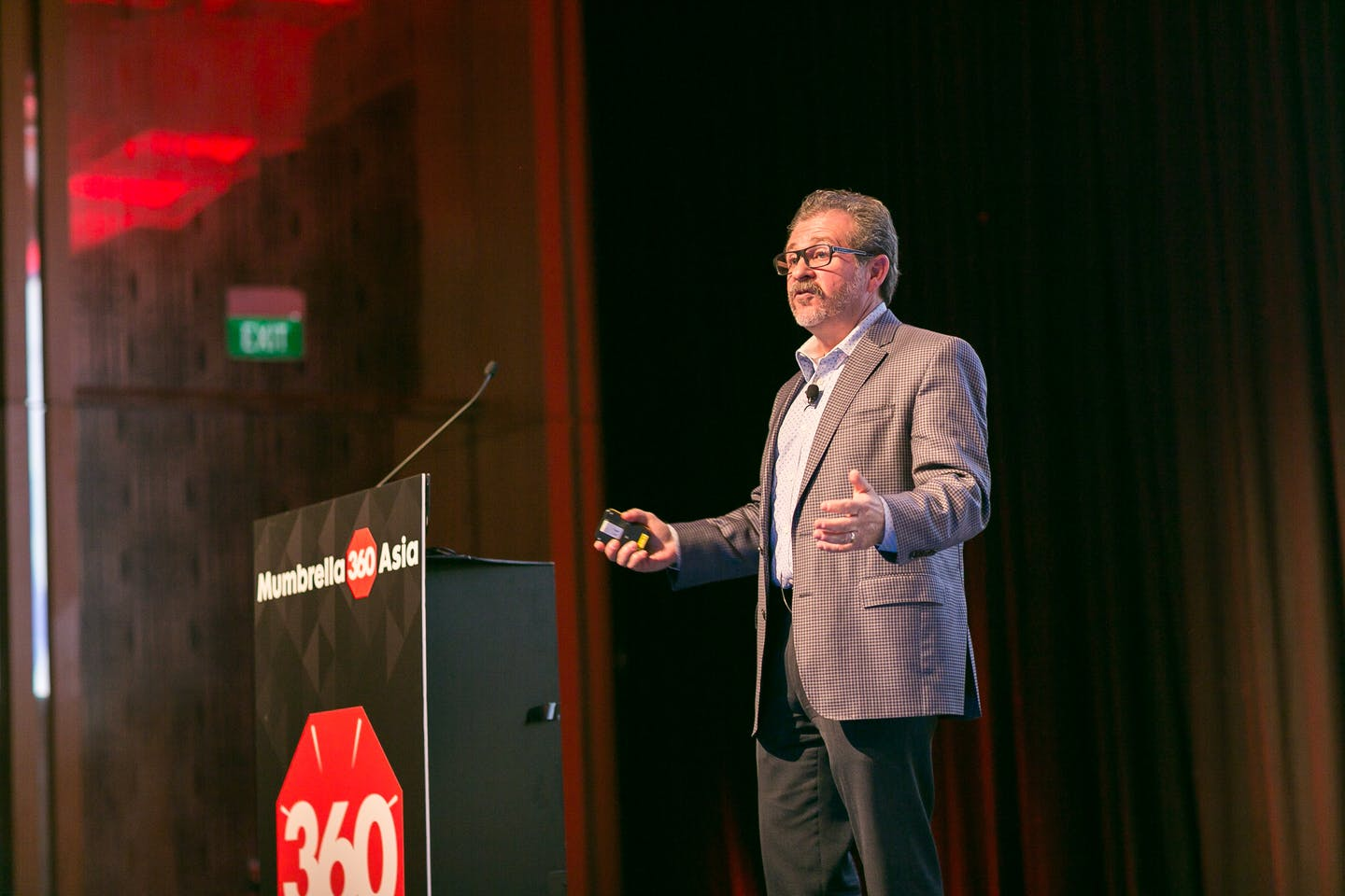 "Lou Hoffman, founder of PR firm The Hoffman Agency, talking at the Mumbrella Asia 360 conference in Singapore: ""Dullness comes from a combination of the lexicon of your company and corporate speak."" Image: Mumbrella"