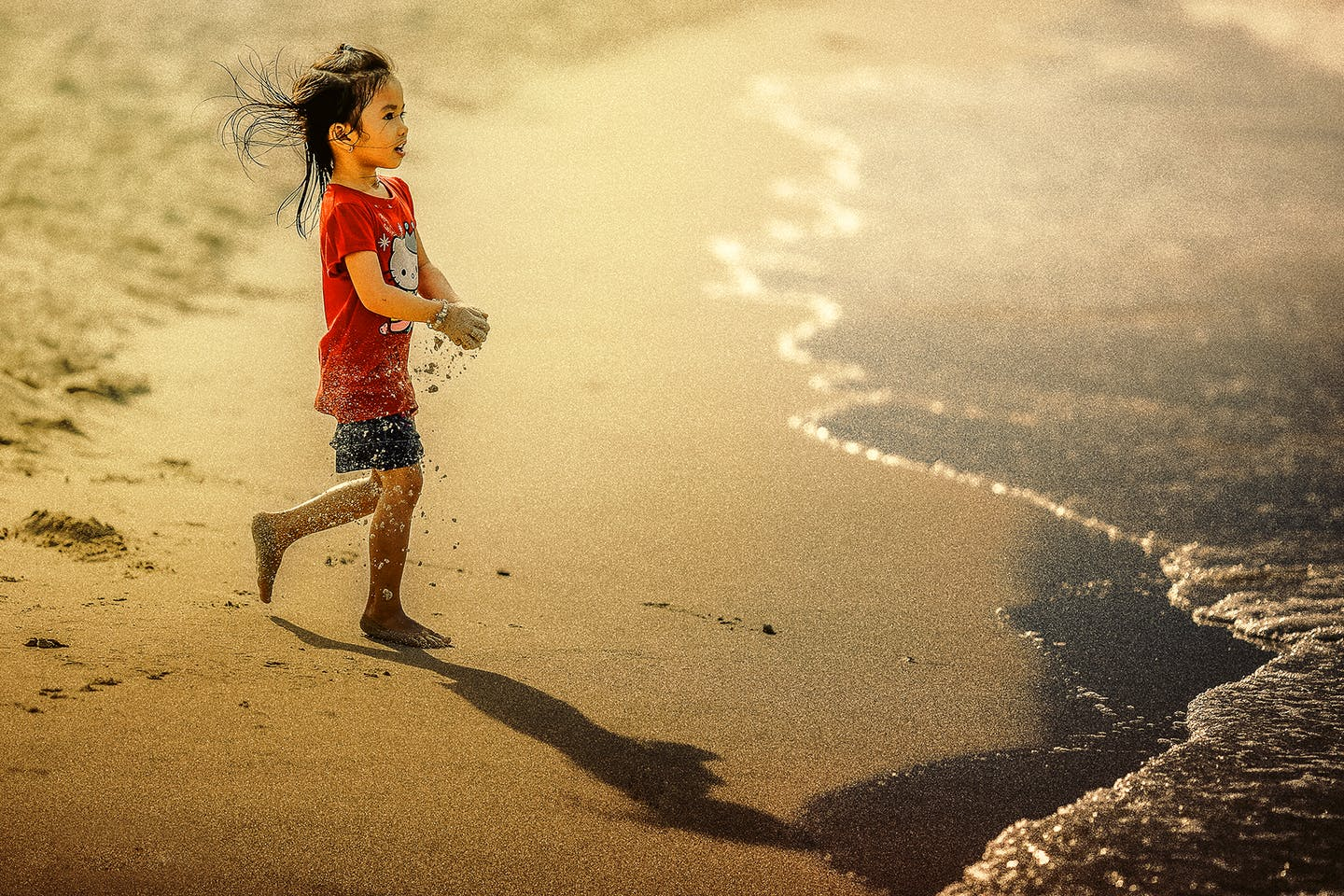 girl rushes to ocean