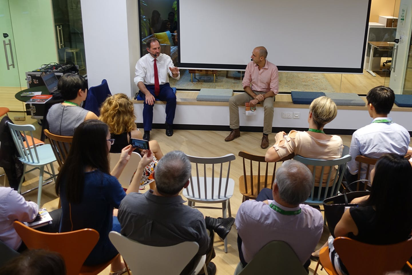 Peter White and Teymoor Nabili debate what the UN's Sustainable Development Goals mean for business at SDG Co in Singapore. Image: Eco-Business