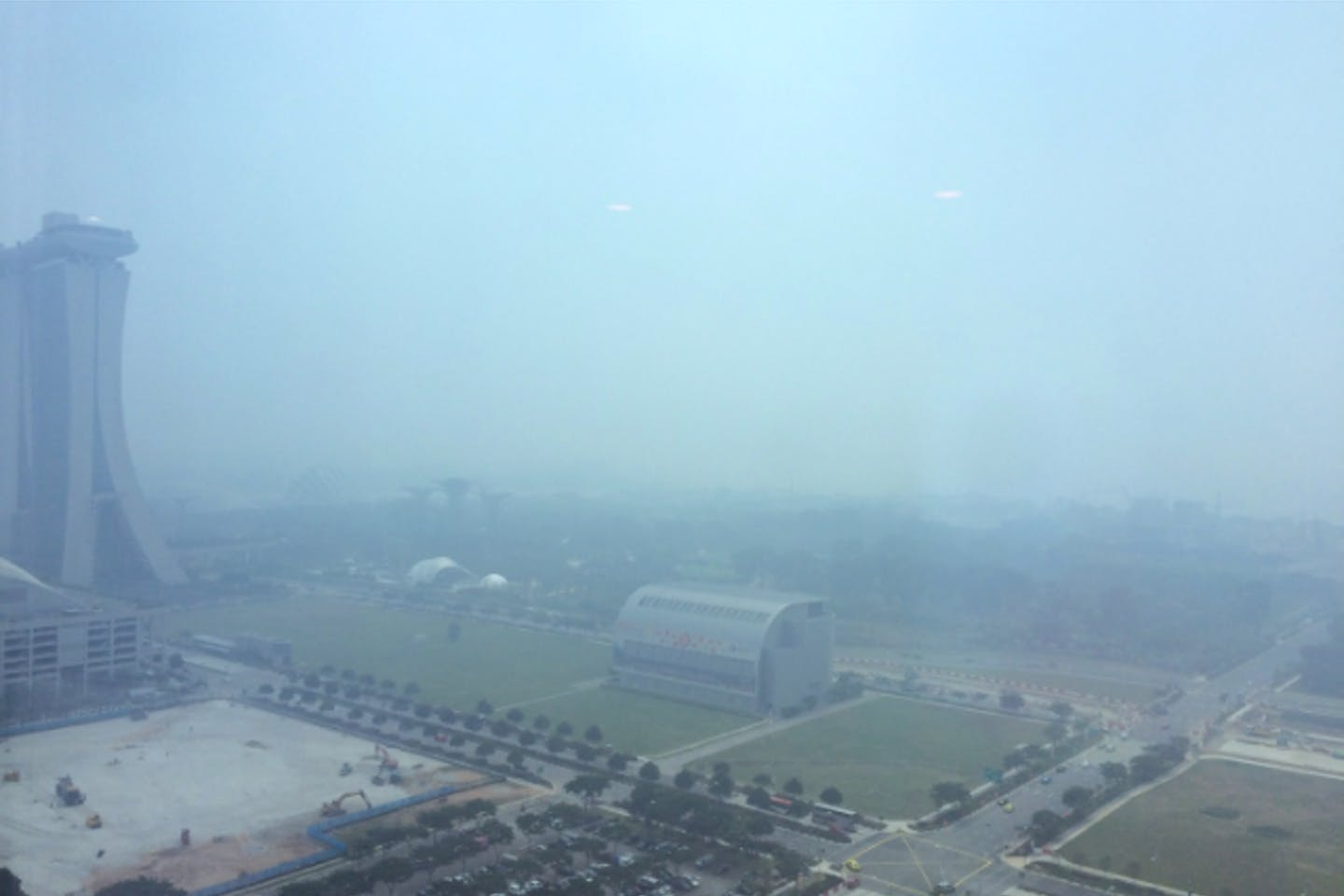The Singapore skyline during the haze of 2015. About one third of the fires are believed to have occured in APP's concessions in South Sumatra. image: Eco-Business