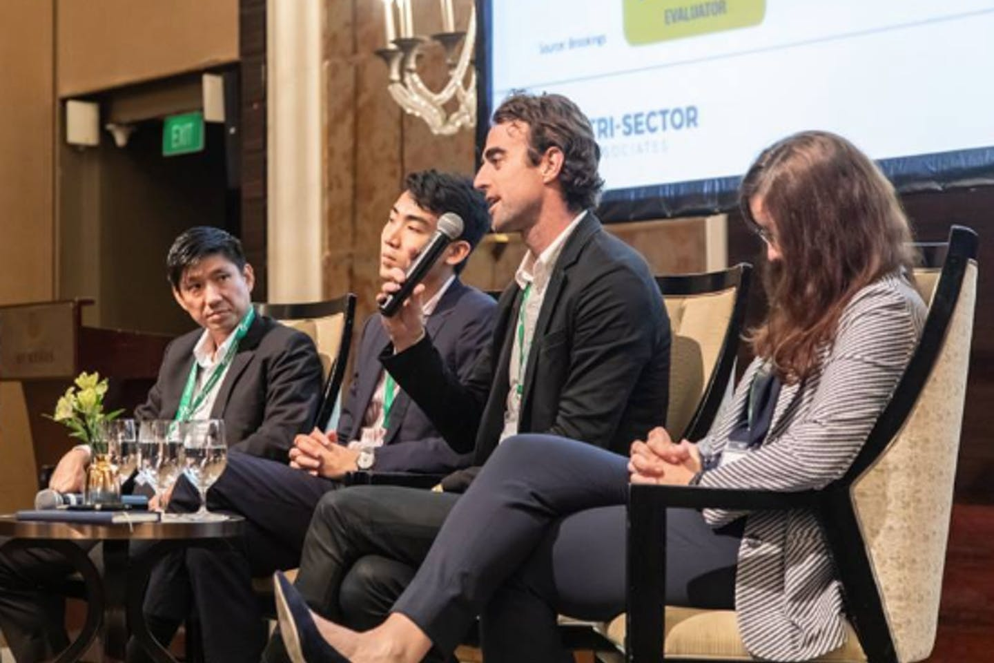 Brian Reilly, founder and chief executive of Revolv, talks on a panel at Unlocking Capital for Sustainability. Reilly raised US$500,000 from Hong Kong-based hedge fund Sylebra and is looking to secure more funding to aid the company's launch in Singapore. Image: Eco-Business