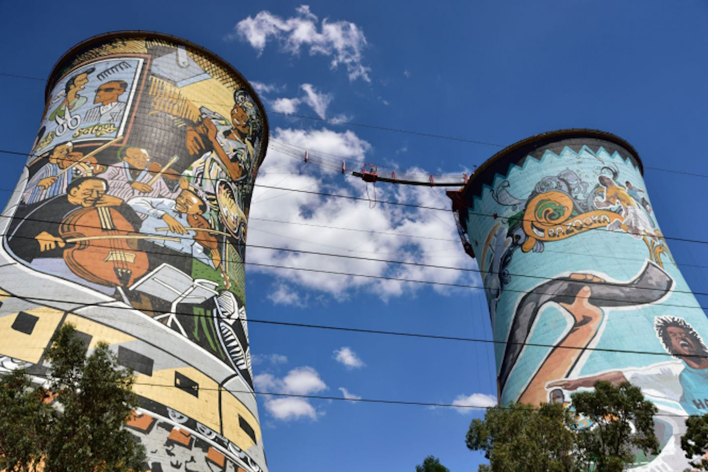the cooling towers of the retired Orlando coal plant in South Africa. The towers now display large murals and advertisements as well as being used as a platform for bungee and BASE jumping