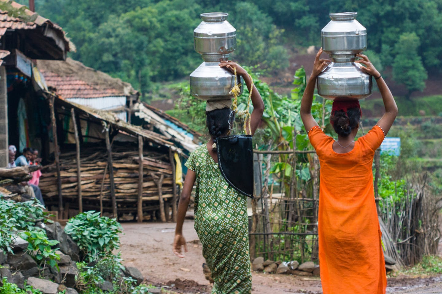 women carrying water pots india