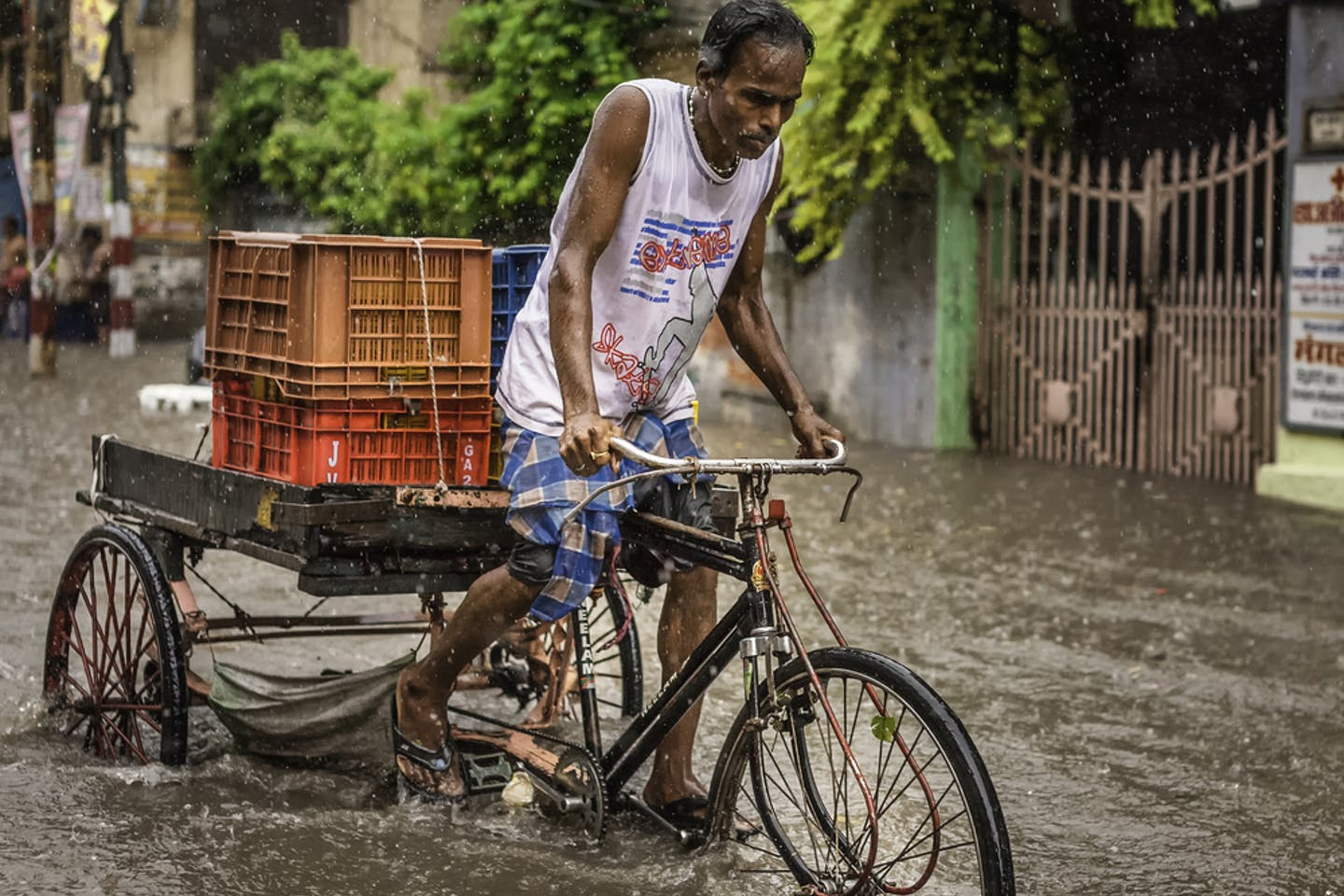man cycles floodwater