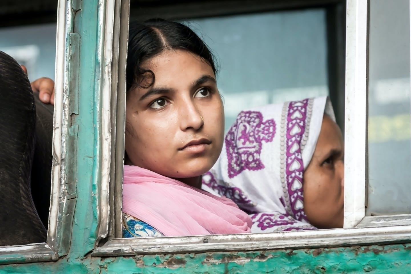 A woman in Dhaka looks out forlornly.