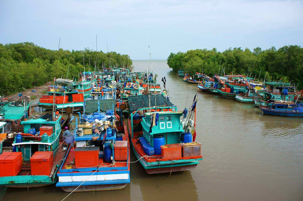 colorful fishing boats mekong vn
