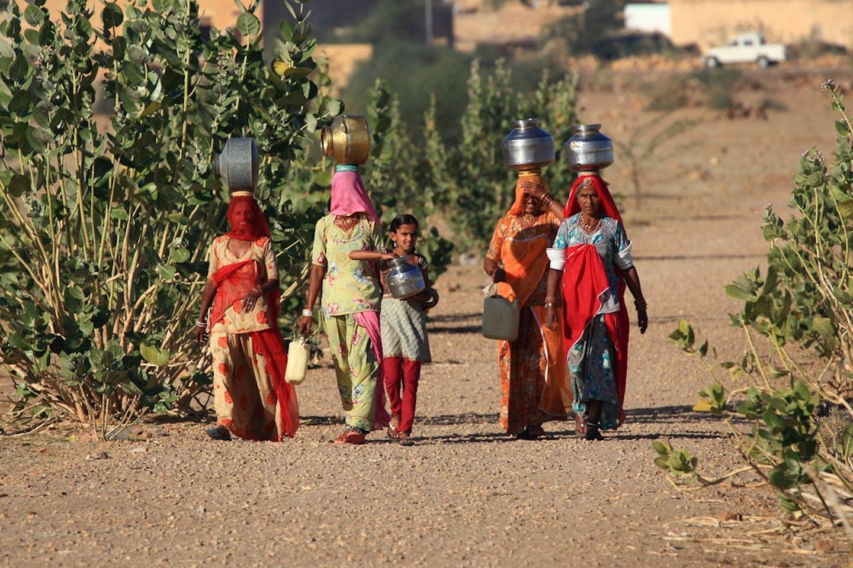 women carrying water india