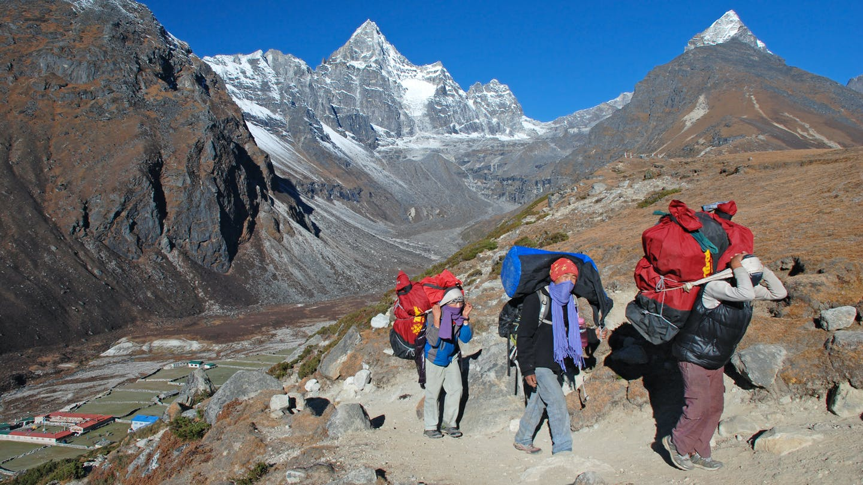 Porters on mountain trek in nepal