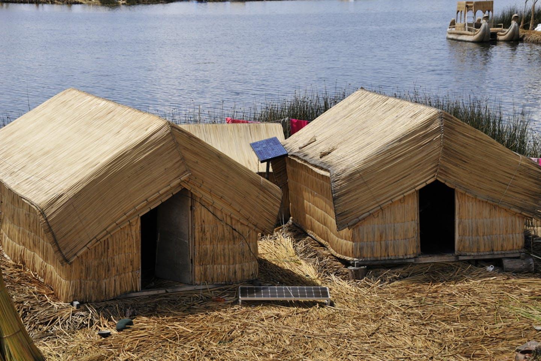 reed hut with solar panels peru