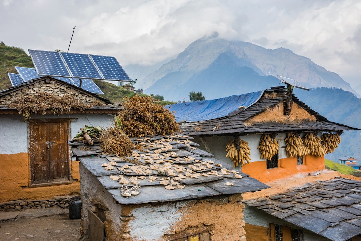 traditional nepali houses with solar panel roofs