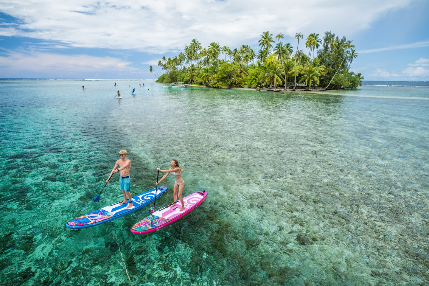 Stand up paddling against very clear waters