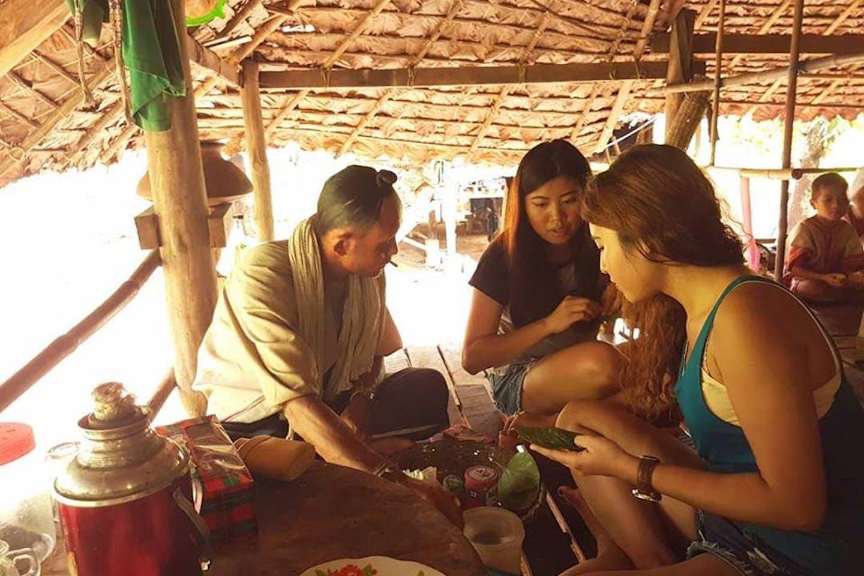 Tourists taste betel nut in a village in Southeast Asia