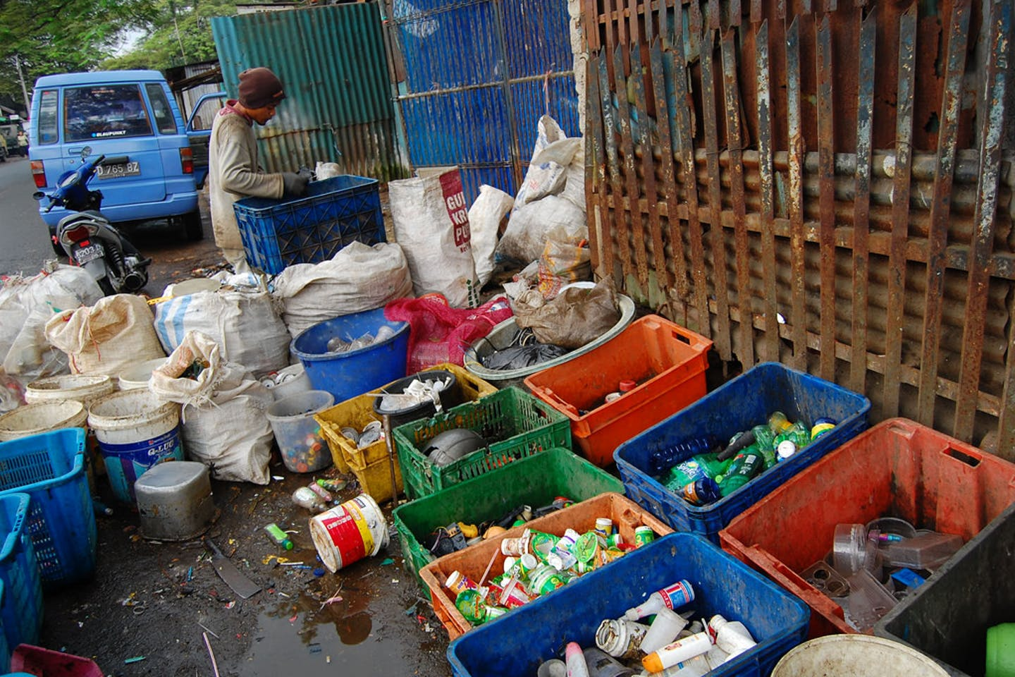 Waste collector in Indonesia segregating trash